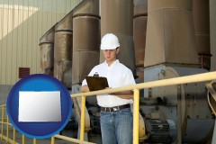 colorado map icon and a mechanical contractor inspecting an industrial ventilation system