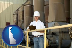 delaware map icon and a mechanical contractor inspecting an industrial ventilation system