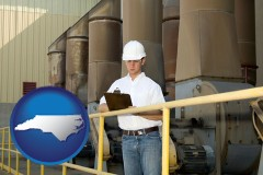 north-carolina map icon and a mechanical contractor inspecting an industrial ventilation system