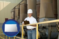 north-dakota map icon and a mechanical contractor inspecting an industrial ventilation system