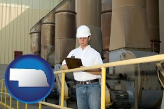nebraska map icon and a mechanical contractor inspecting an industrial ventilation system