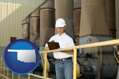 oklahoma map icon and a mechanical contractor inspecting an industrial ventilation system