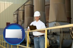 south-dakota map icon and a mechanical contractor inspecting an industrial ventilation system