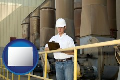 wyoming map icon and a mechanical contractor inspecting an industrial ventilation system