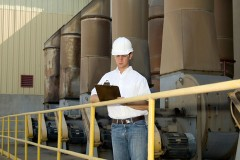 a mechanical contractor inspecting an industrial ventilation system