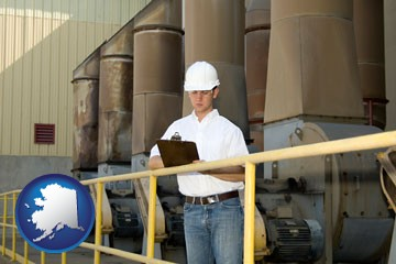 a mechanical contractor inspecting an industrial ventilation system - with Alaska icon