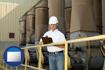 a mechanical contractor inspecting an industrial ventilation system - with Colorado icon