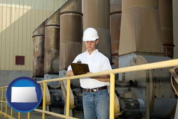 a mechanical contractor inspecting an industrial ventilation system - with North Dakota icon