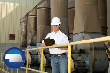 a mechanical contractor inspecting an industrial ventilation system - with Nebraska icon