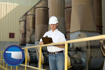 a mechanical contractor inspecting an industrial ventilation system - with Oklahoma icon