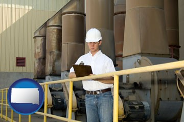 a mechanical contractor inspecting an industrial ventilation system - with South Dakota icon