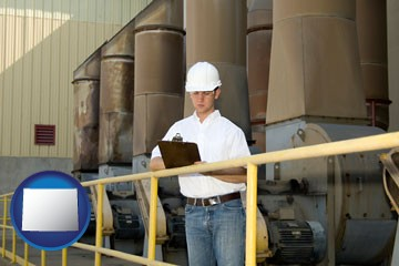 a mechanical contractor inspecting an industrial ventilation system - with Wyoming icon